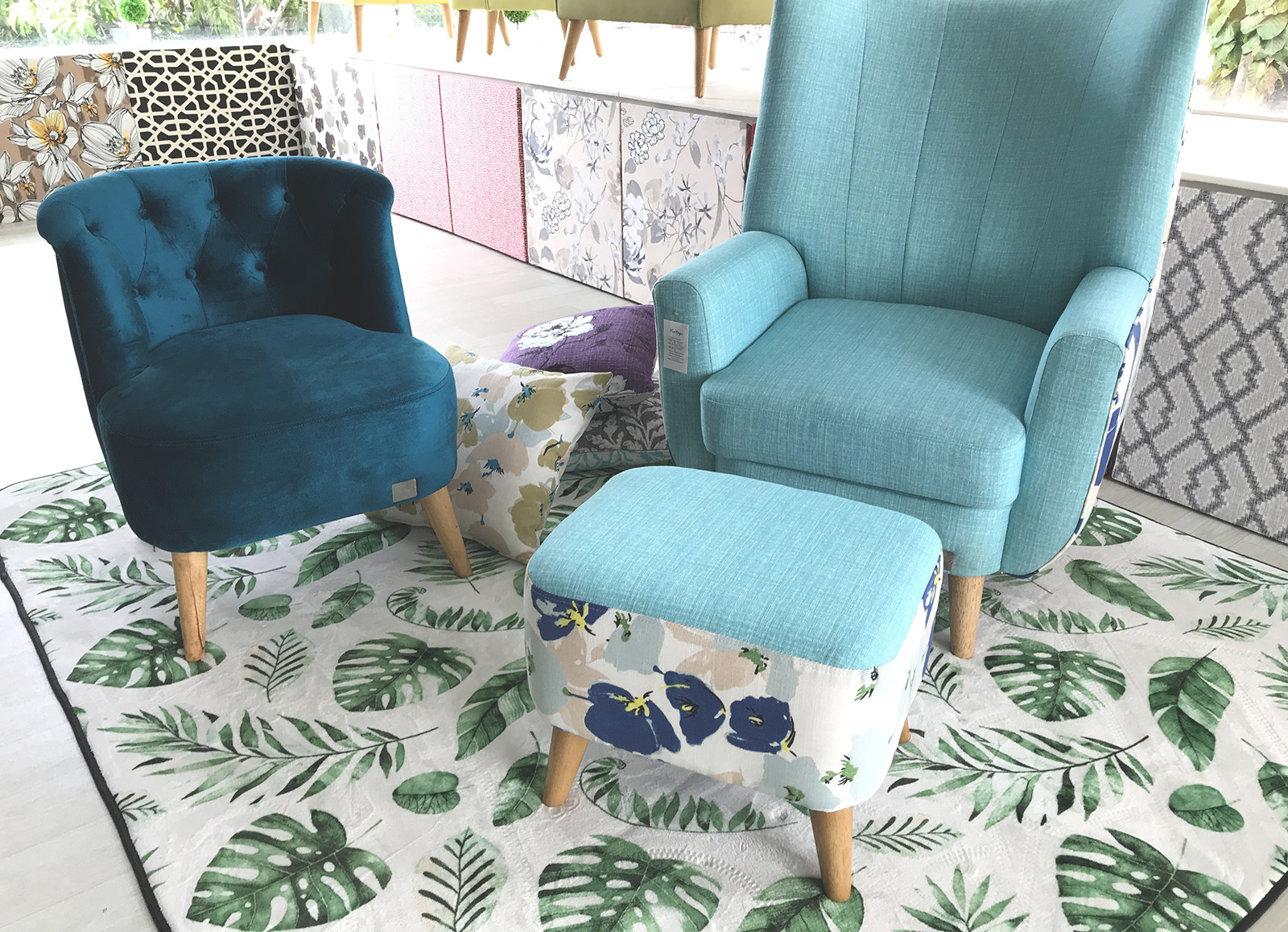 Blue Harisson slipper, Evelyn Armchair with Jackson Footstool and some throw pillow on the floor.
