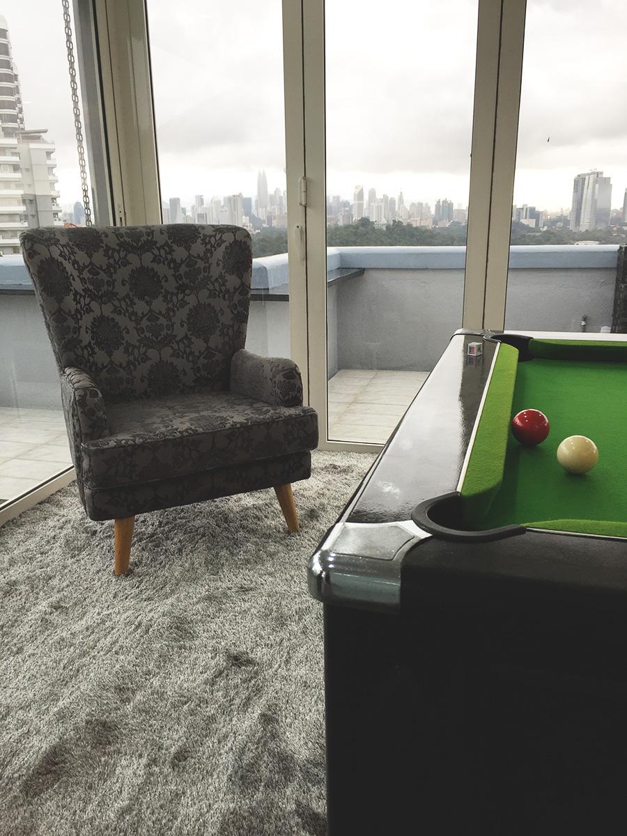 Sanderson fan back armchair beside a pool table